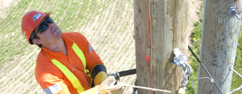 powerline-worker-climbing-hydro-pole